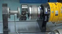 Rotary cylinder series AT with flexible coupling and torque sensor.